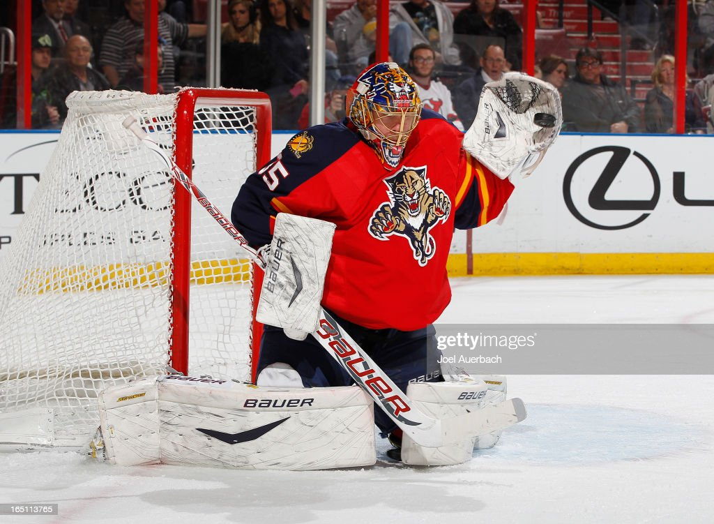 Goaltender Jacob Markstrom #35 of the Florida Panthers stops a shot by the New Jersey Devils at the BB&T Center on March 30, 2013 in Sunrise, Florida.