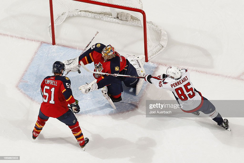 Goaltender <a gi-track='captionPersonalityLinkClicked' href=/galleries/search?phrase=Jacob+Markstrom&family=editorial&specificpeople=5370948 ng-click='$event.stopPropagation()'>Jacob Markstrom</a> #35 of the Florida Panthers stops a shot by <a gi-track='captionPersonalityLinkClicked' href=/galleries/search?phrase=Mathieu+Perreault&family=editorial&specificpeople=776813 ng-click='$event.stopPropagation()'>Mathieu Perreault</a> #85 of the Washington Capitals at the BB&T Center on April 6, 2013 in Sunrise, Florida. The Capitals defeated the Panthers 4-3.