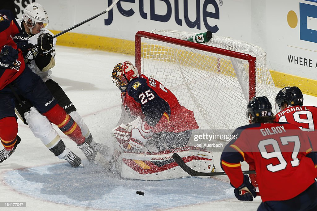 Goaltender <a gi-track='captionPersonalityLinkClicked' href=/galleries/search?phrase=Jacob+Markstrom&family=editorial&specificpeople=5370948 ng-click='$event.stopPropagation()'>Jacob Markstrom</a> #25 of the Florida Panthers stops a shot by <a gi-track='captionPersonalityLinkClicked' href=/galleries/search?phrase=Evgeni+Malkin&family=editorial&specificpeople=221676 ng-click='$event.stopPropagation()'>Evgeni Malkin</a> #71 of the Pittsburgh Penguins at the BB&T Center on October 11, 2013 in Sunrise, Florida. The Panthers defeated the Penguins 6-3.