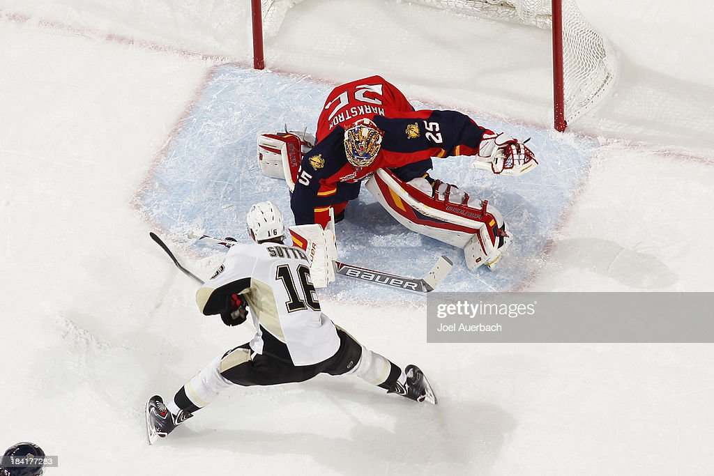 Goaltender <a gi-track='captionPersonalityLinkClicked' href=/galleries/search?phrase=Jacob+Markstrom&family=editorial&specificpeople=5370948 ng-click='$event.stopPropagation()'>Jacob Markstrom</a> #25 of the Florida Panthers stops a shot by <a gi-track='captionPersonalityLinkClicked' href=/galleries/search?phrase=Brandon+Sutter&family=editorial&specificpeople=2086411 ng-click='$event.stopPropagation()'>Brandon Sutter</a> #16 of the Pittsburgh Penguins at the BB&T Center on October 11, 2013 in Sunrise, Florida. The Panthers defeated the Penguins 6-3.