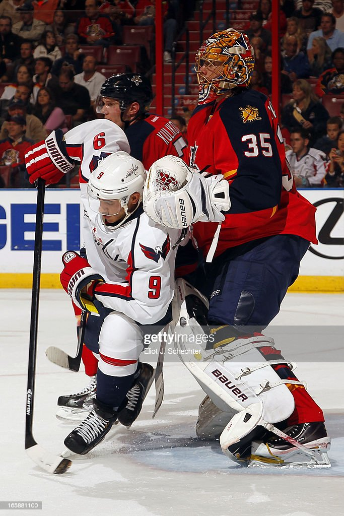 Goaltender <a gi-track='captionPersonalityLinkClicked' href=/galleries/search?phrase=Jacob+Markstrom&family=editorial&specificpeople=5370948 ng-click='$event.stopPropagation()'>Jacob Markstrom</a> #35 of the Florida Panthers tangles with <a gi-track='captionPersonalityLinkClicked' href=/galleries/search?phrase=Mike+Ribeiro&family=editorial&specificpeople=203275 ng-click='$event.stopPropagation()'>Mike Ribeiro</a> #9 of the Washington Capitals at the BB&T Center on April 6, 2013 in Sunrise, Florida.