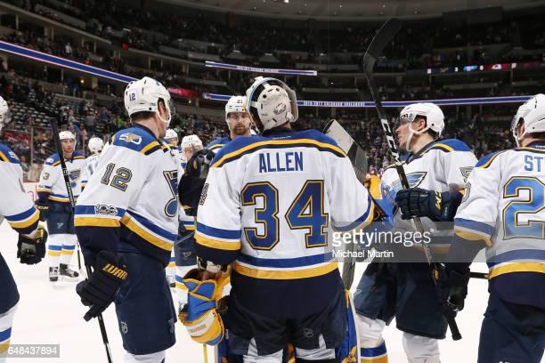 Goaltender Jake Allen of the St Louis Blues celebrates a shutout against the Colorado Avalanche with teammates Jori Lehtera Patrik Berglund and David...