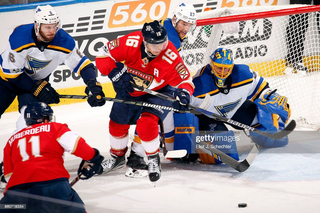 Goaltender Jake Allen #34 of the St. Louis Blues defends the net with the help of teammate Alex Pietrangelo #27 against Aleksander Barkov #16 of the Florida Panthers at the BB&T Center on October 12, 2017 in Sunrise, Florida.