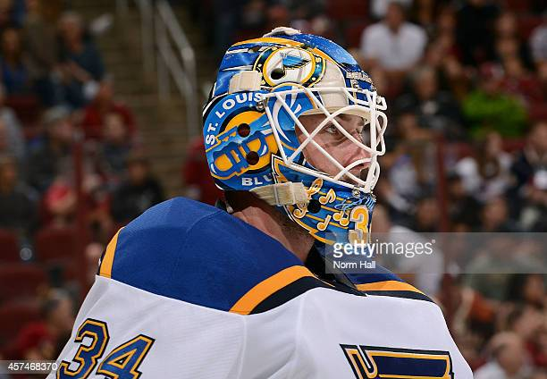 Goaltender Jake Allen of the St Louis Blues looks on during the third period of an NHL game against the Arizona Coyotes at Gila River Arena on...