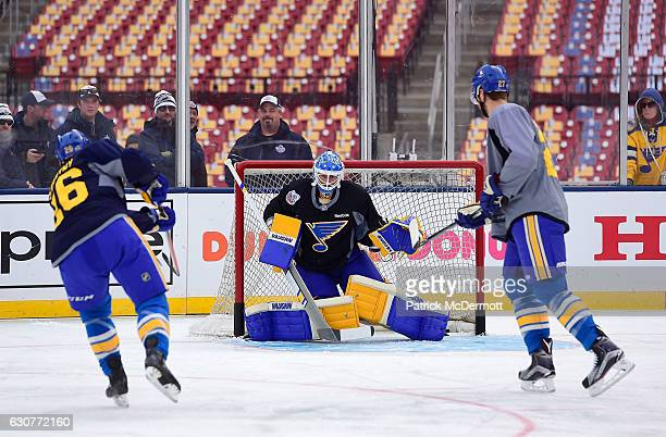 Goaltender Jake Allen of the St Louis Blues makes a save during practice for the 2017 Bridgestone NHL Winter Classic at Busch Stadium on January 1...