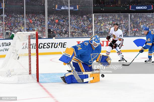 Goaltender Jake Allen of the St Louis Blues makes a save in the first period during the 2017 Bridgestone NHL Winter Classic at Busch Stadium on...