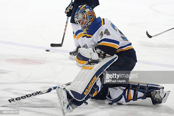 Goaltender Jake Allen of the St Louis Blues stretches prior to the game against the Colorado Avalanche at the Pepsi Center on December 13 2014 in...