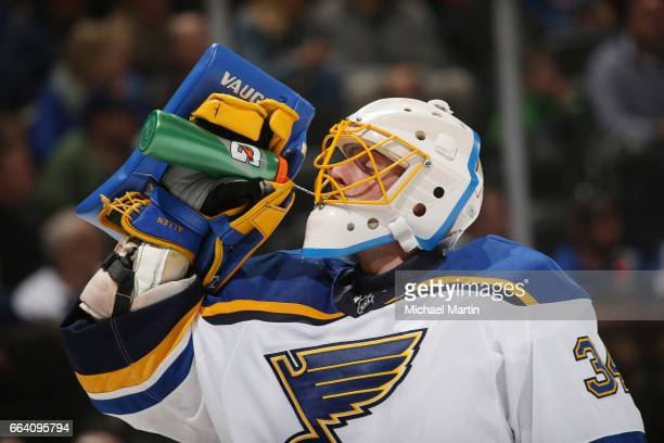 Goaltender Jake Allen of the St Louis Blues takes a drink against the Colorado Avalanche at the Pepsi Center on March 31 2017 in Denver Colorado The...