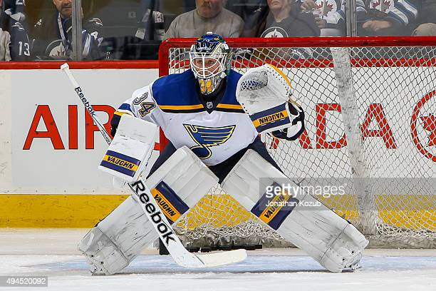 Goaltender Jake Allen of the St Louis Blues takes part in the pregame warm up prior to NHL action against the Winnipeg Jets at the MTS Centre on...