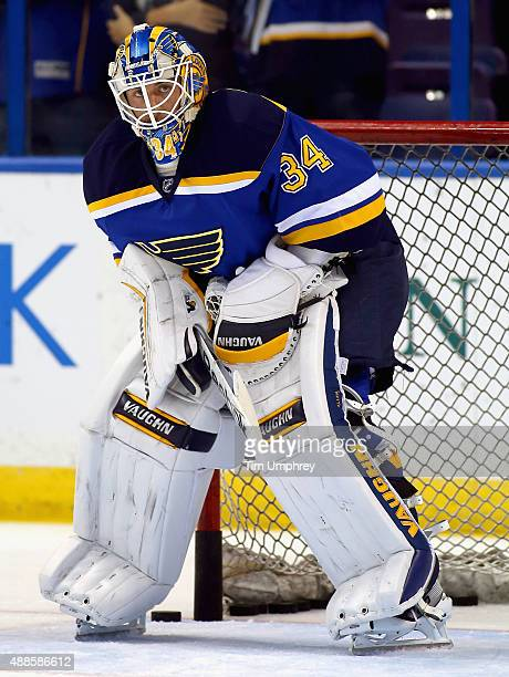 Goaltender Jake Allen of the St Louis Blues warms up before playing in the game against the New York Rangers at the Scottrade Center on October 9...