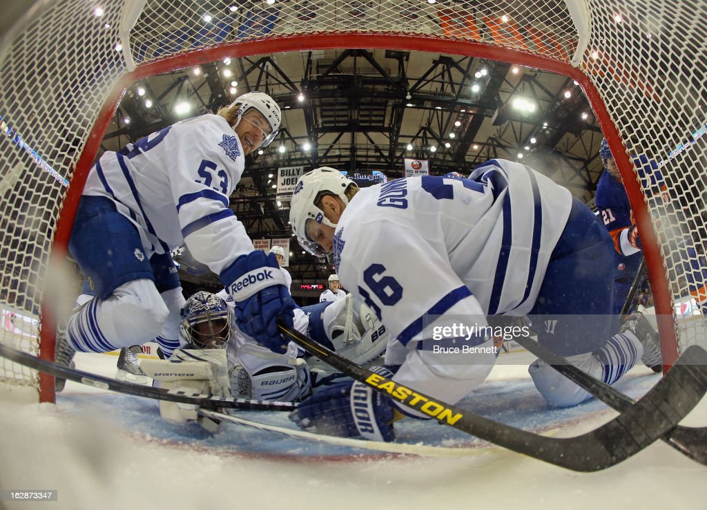 Goaltender James Reimer #34 and defensemen Mike Kostka #53 and <a gi-track='captionPersonalityLinkClicked' href=/galleries/search?phrase=Carl+Gunnarsson&family=editorial&specificpeople=5557315 ng-click='$event.stopPropagation()'>Carl Gunnarsson</a> #36 of the Toronto Maple Leafs manage to stop <a gi-track='captionPersonalityLinkClicked' href=/galleries/search?phrase=Kyle+Okposo&family=editorial&specificpeople=540469 ng-click='$event.stopPropagation()'>Kyle Okposo</a> #21 of the New York Islanders in the first period at the Nassau Veterans Memorial Coliseum on February 28, 2013 in Uniondale, New York.