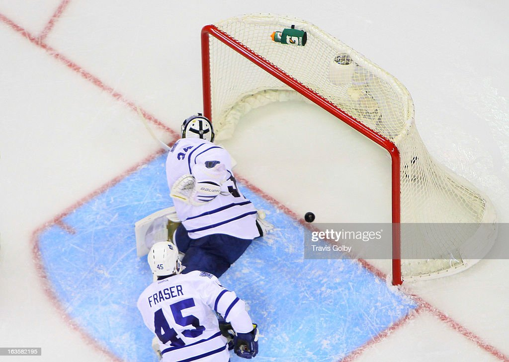 Goaltender James Reimer #34 and <a gi-track='captionPersonalityLinkClicked' href=/galleries/search?phrase=Mark+Fraser+-+Ice+Hockey+Player&family=editorial&specificpeople=5513661 ng-click='$event.stopPropagation()'>Mark Fraser</a> #45 of the Toronto Maple Leafs look to the net as the puck crosses the line for a second period goal by the Winnipeg Jets at the MTS Centre on March 12, 2013 in Winnipeg, Manitoba, Canada.