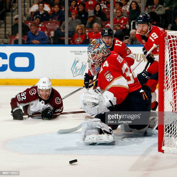Goaltender James Reimer of the Florida Panthers defends the net against Gabriel Landeskog of the Colorado Avalanche at the BBT Center on December 9...