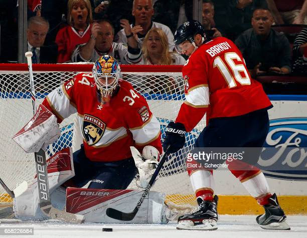 Goaltender James Reimer of the Florida Panthers defends the net with the help of teammate Aleksander Barkov against the Chicago Blackhawks at the BBT...