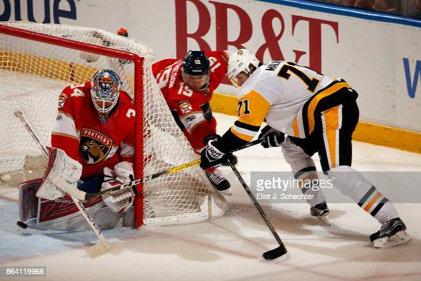 Goaltender James Reimer of the Florida Panthers defends the net with the help of teammate Michael Matheson against Evgeni Malkin of the Pittsburgh...