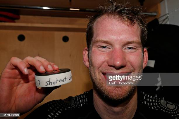 Goaltender James Reimer of the Florida Panthers holds a puck in the dressing room after a shut out against the Chicago Blackhawks at the BBT Center...