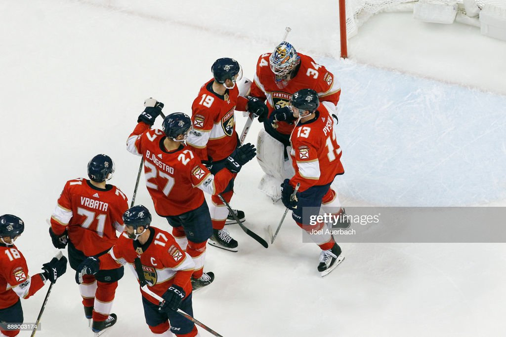 Goaltender James Reimer #34 of the Florida Panthers is congratulated by teammates after the victory against the Winnipeg Jets at the BB&T Center on December 7, 2017 in Sunrise, Florida. The Panthers defeated the Jets 6-4.