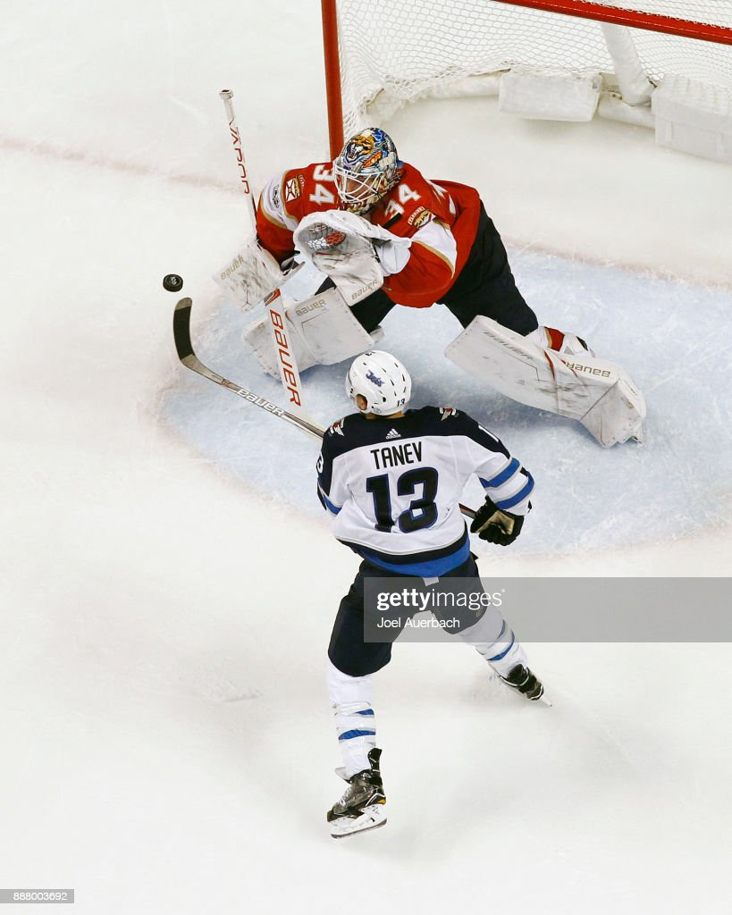 Goaltender James Reimer #34 of the Florida Panthers stops the shot on a deflection by Brandon Tanev #13 of the Winnipeg Jets during third period action at the BB&T Center on December 7, 2017 in Sunrise, Florida. The Panthers defeated the Jets 6-4.