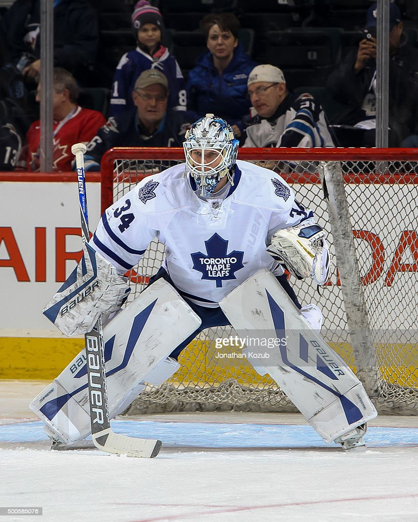 Goaltender <a gi-track='captionPersonalityLinkClicked' href=/galleries/search?phrase=James+Reimer+-+Hockey+Player&family=editorial&specificpeople=7543302 ng-click='$event.stopPropagation()'>James Reimer</a> #34 of the Toronto Maple Leafs takes part in the pre-game warm up prior to NHL action against the Winnipeg Jets at the MTS Centre on December 2, 2015 in Winnipeg, Manitoba, Canada.