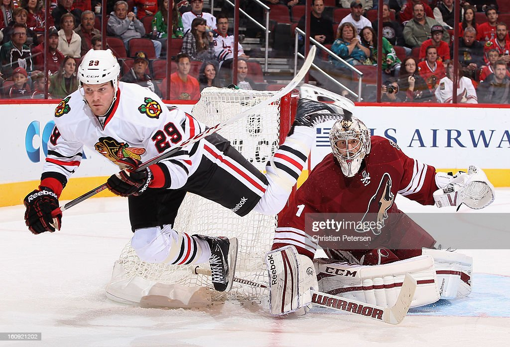 Goaltender <a gi-track='captionPersonalityLinkClicked' href=/galleries/search?phrase=Jason+LaBarbera&family=editorial&specificpeople=240674 ng-click='$event.stopPropagation()'>Jason LaBarbera</a> #1 of the Phoenix Coyotes follows the action as Bryan Bickell #29 of the Chicago Blackhawks is tripped up during the third period of the NHL game at Jobing.com Arena on February 7, 2013 in Glendale, Arizona. The Blackhawks defeated the Coyotes 6-2.