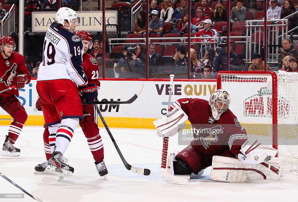 Goaltender Jason LaBarbera #1 of the Phoenix Coyotes makes a glove save on the shot past <a gi-track='captionPersonalityLinkClicked' href=/galleries/search?phrase=Ryan+Johansen&family=editorial&specificpeople=6698841 ng-click='$event.stopPropagation()'>Ryan Johansen</a> #19 of the Columbus Blue Jackets during the NHL game at Jobing.com Arena on January 23, 2013 in Glendale, Arizona. The Coyotes defeated the Blue Jackets 5-1.