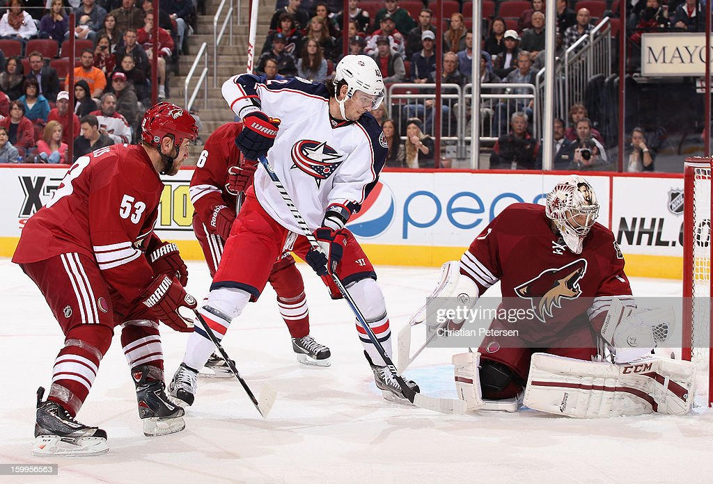 Goaltender <a gi-track='captionPersonalityLinkClicked' href=/galleries/search?phrase=Jason+LaBarbera&family=editorial&specificpeople=240674 ng-click='$event.stopPropagation()'>Jason LaBarbera</a> #1 of the Phoenix Coyotes makes a glove save on the shot past Artem Anisimov #42 of the Columbus Blue Jackets during the NHL game at Jobing.com Arena on January 23, 2013 in Glendale, Arizona. The Coyotes defeated the Blue Jackets 5-1.
