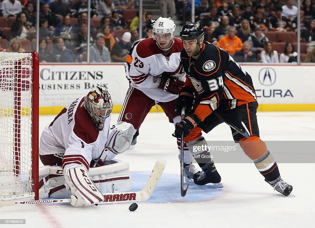 Goaltender <a gi-track='captionPersonalityLinkClicked' href=/galleries/search?phrase=Jason+LaBarbera&family=editorial&specificpeople=240674 ng-click='$event.stopPropagation()'>Jason LaBarbera</a> #1 of the Phoenix Coyotes makes a save, as <a gi-track='captionPersonalityLinkClicked' href=/galleries/search?phrase=Oliver+Ekman-Larsson&family=editorial&specificpeople=5894618 ng-click='$event.stopPropagation()'>Oliver Ekman-Larsson</a> #23 of the Coyotes and <a gi-track='captionPersonalityLinkClicked' href=/galleries/search?phrase=Daniel+Winnik&family=editorial&specificpeople=2529214 ng-click='$event.stopPropagation()'>Daniel Winnik</a> #34 of the Anaheim Ducks pursue in the third period at Honda Center on April 27, 2013 in Anaheim, California. The Coyotes defeated the Ducks 5-3.