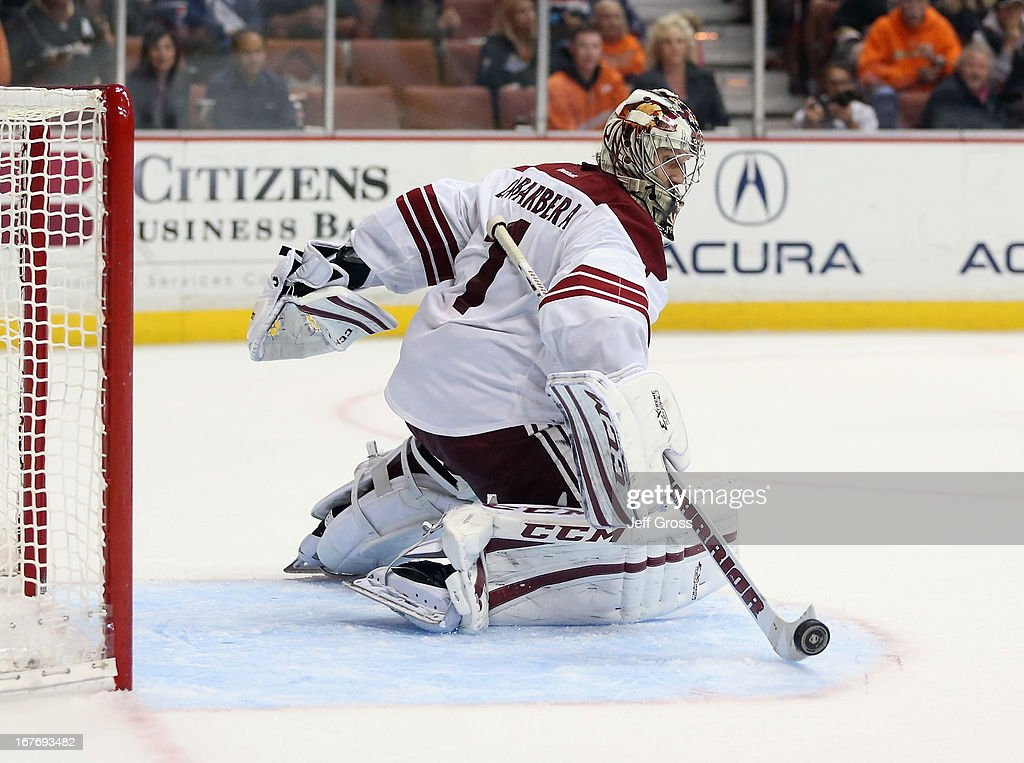 Goaltender <a gi-track='captionPersonalityLinkClicked' href=/galleries/search?phrase=Jason+LaBarbera&family=editorial&specificpeople=240674 ng-click='$event.stopPropagation()'>Jason LaBarbera</a> #1 of the Phoenix Coyotes makes a save against the Anaheim Ducks in the third period at Honda Center on April 27, 2013 in Anaheim, California. The Coyotes defeated the Ducks 5-3.