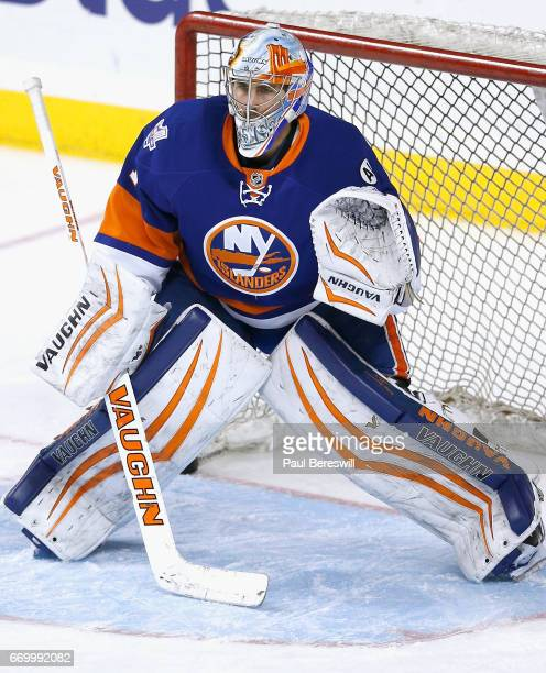 Goaltender Jean Francois Berube of the New York Islanders warms up before the game against the Ottawa Senators at Barclays Center on March 23 2016 in...