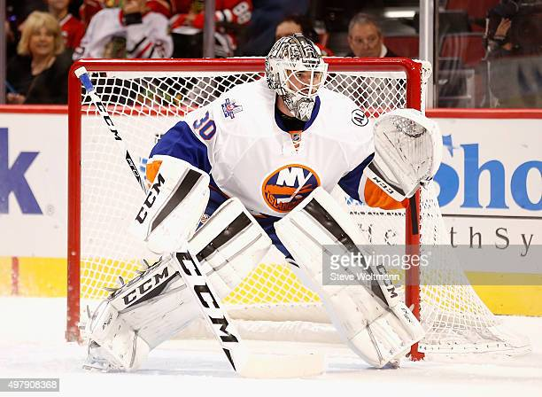 Goaltender JeanFrancois Berube of the New York Islanders plays in the game against the Chicago Blackhawks at the United Center on October 10 2015 in...
