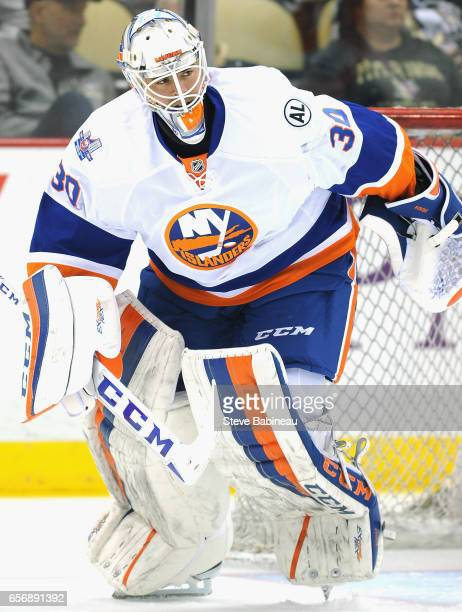 Goaltender JeanFrancois Berube of the New York Islanders plays in the game against the Pittsburgh Penguins at the Consol Energy Center on March 15...
