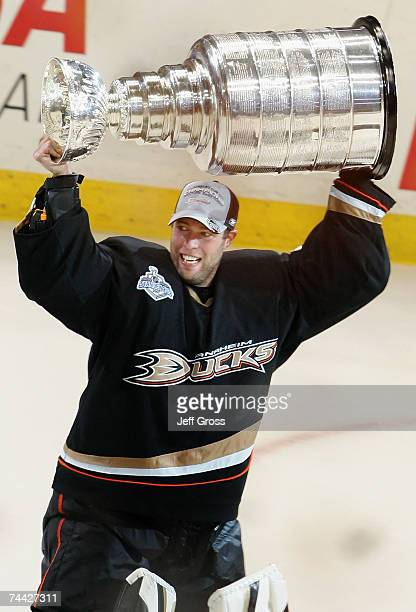 Goaltender JeanSebastien Giguere of the Anaheim Ducks celebrates lifting the Stanley Cup after defeating the Ottawa Senators in Game Five of the 2007...