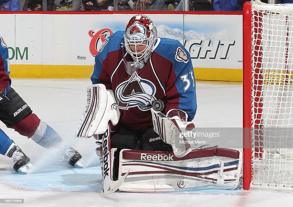 Goaltender Jean-Sebastien Giguere #35 of the Colorado Avalanche makes a save against the Detroit Red Wings at the Pepsi Center on April 5, 2013 in Denver, Colorado.