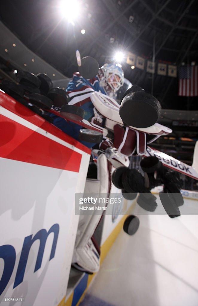 Goaltender Jean-Sebastien Giguere #35 of the Colorado Avalanche pushes pucks to the ice prior to the game against the Dallas Stars at the Pepsi Center on February 4, 2013 in Denver, Colorado. The Stars defeated the Avalanche 3-2.