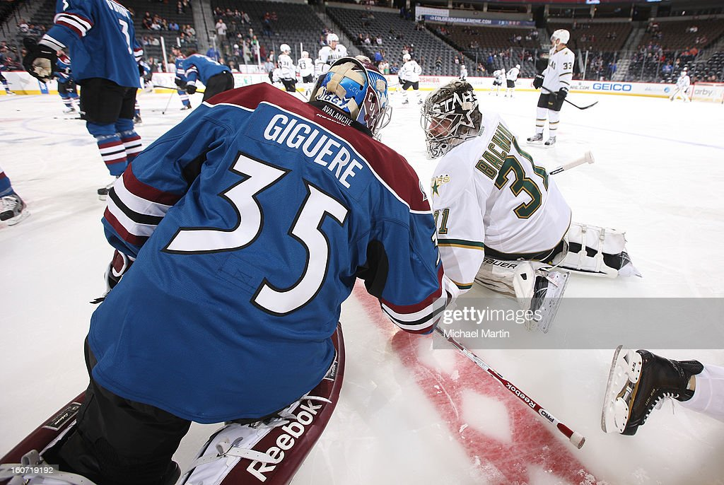 Goaltender Jean-Sebastien Giguere #35 of the Colorado Avalanche talks to goaltender Richard Bachman #31 prior to the game against the Dallas Stars at the Pepsi Center on February 4, 2013 in Denver, Colorado.