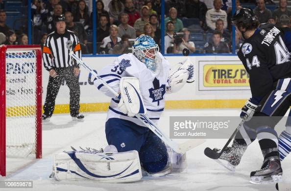 Goaltender JeanSebastien Giguere of the Toronto Maple Leafs defends the goal against Nate Thompson the Tampa Bay Lightning at the St Pete Times Forum...