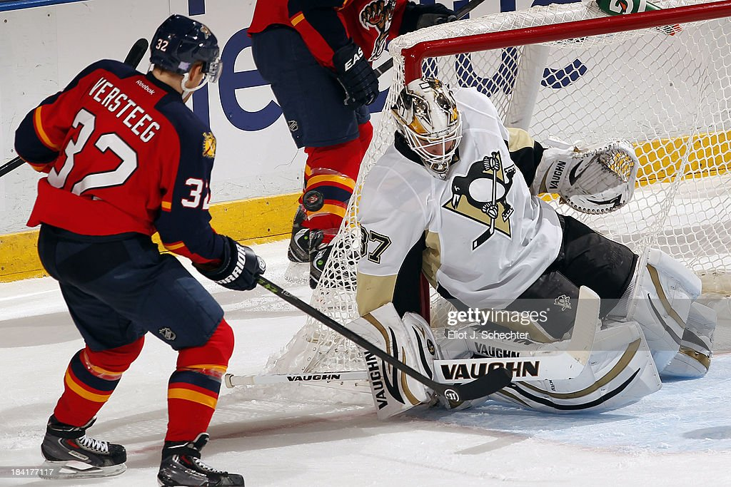 Goaltender <a gi-track='captionPersonalityLinkClicked' href=/galleries/search?phrase=Jeff+Zatkoff&family=editorial&specificpeople=1985171 ng-click='$event.stopPropagation()'>Jeff Zatkoff</a> #37 of the Pittsburgh Penguins defends the net against <a gi-track='captionPersonalityLinkClicked' href=/galleries/search?phrase=Kris+Versteeg&family=editorial&specificpeople=2242969 ng-click='$event.stopPropagation()'>Kris Versteeg</a> #32 of the Florida Panthers at the BB&T Center on October 11, 2013 in Sunrise, Florida.