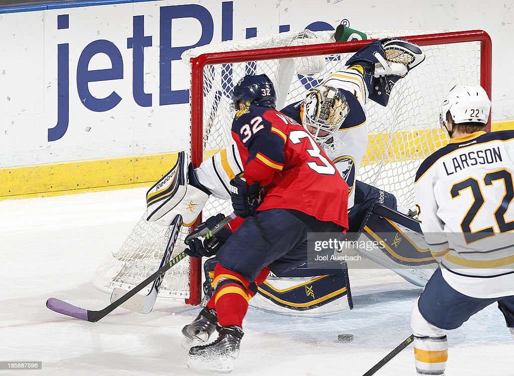 Goaltender <a gi-track='captionPersonalityLinkClicked' href=/galleries/search?phrase=Jhonas+Enroth&family=editorial&specificpeople=570456 ng-click='$event.stopPropagation()'>Jhonas Enroth</a> #1 of the Buffalo Sabres stops a shot by <a gi-track='captionPersonalityLinkClicked' href=/galleries/search?phrase=Kris+Versteeg&family=editorial&specificpeople=2242969 ng-click='$event.stopPropagation()'>Kris Versteeg</a> #32 of the Florida Panthers at the BB&T Center on October 25, 2013 in Sunrise, Florida. The Sabres defeated the Panthers 3-1.