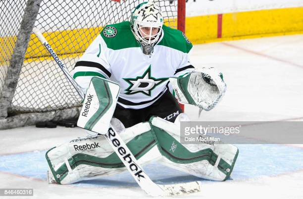 Goaltender Jhonas Enroth of the Dallas Stars warms up before the game against the Edmonton Oilers at Rexall Place on March 27 2015 in Edmonton...