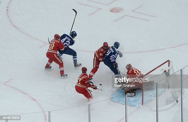Goaltender Jimmy Howard and Kyle Quincey of the Detroit Red Wings defend their net as teammates Pavel Datsyuk and Danny DeKeyser defend Tyler Bozak...