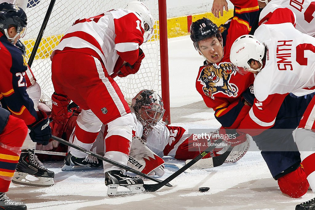Goaltender <a gi-track='captionPersonalityLinkClicked' href=/galleries/search?phrase=Jimmy+Howard&family=editorial&specificpeople=2118637 ng-click='$event.stopPropagation()'>Jimmy Howard</a> #35 of the Detroit Red Wings defends the net against the Florida Panthers at the BB&T Center on December 10, 2013 in Sunrise, Florida.