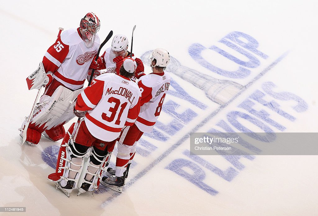 Goaltender Jimmy Howard #35 of the Detroit Red Wings is congratulated by teammates after defeating the Phoenix Coyotes in Game Three of the Western Conference Quarterfinals during the 2011 NHL Stanley Cup Playoffs at Jobing.com Arena on April 18, 2011 in Glendale, Arizona. The Red Wings defeated the Coyotes 4-2.