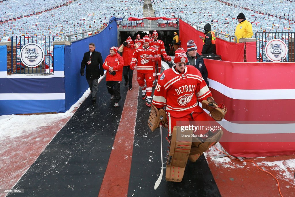 Goaltender Jimmy Howard of the Detroit Red Wings leads his teammates to the ice surface during the 2014 Bridgestone NHL Winter Classic team practice...
