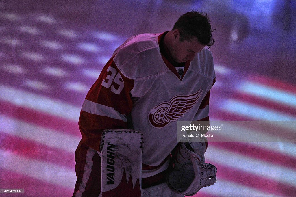 Goaltender <a gi-track='captionPersonalityLinkClicked' href=/galleries/search?phrase=Jimmy+Howard&family=editorial&specificpeople=2118637 ng-click='$event.stopPropagation()'>Jimmy Howard</a> #35 of the Detroit Red Wings looks on before a NHL game against the Florida Panthers at the BB&T Center on December 10, 2013 in Sunrise, Florida.