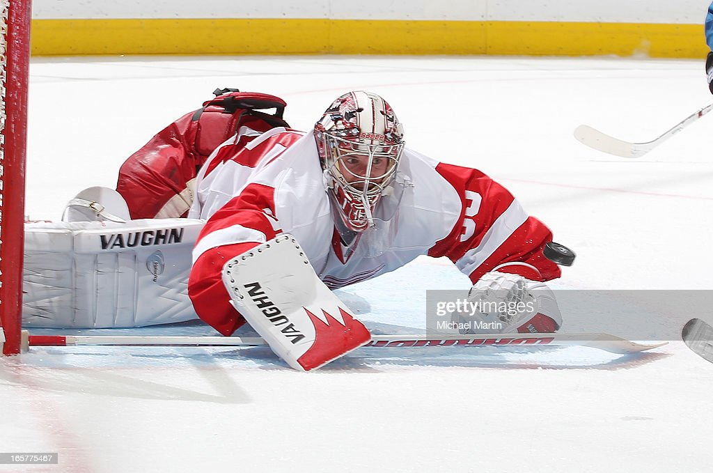 Goaltender <a gi-track='captionPersonalityLinkClicked' href=/galleries/search?phrase=Jimmy+Howard&family=editorial&specificpeople=2118637 ng-click='$event.stopPropagation()'>Jimmy Howard</a> #35 of the Detroit Red Wings makes a save against the Colorado Avalanche at the Pepsi Center on April 5, 2013 in Denver, Colorado. Detroit beat Colorado 302 in overtime.