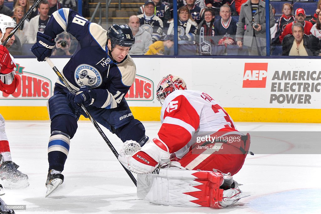 Goaltender <a gi-track='captionPersonalityLinkClicked' href=/galleries/search?phrase=Jimmy+Howard&family=editorial&specificpeople=2118637 ng-click='$event.stopPropagation()'>Jimmy Howard</a> #35 of the Detroit Red Wings makes a save on a close in shot from <a gi-track='captionPersonalityLinkClicked' href=/galleries/search?phrase=R.J.+Umberger&family=editorial&specificpeople=636608 ng-click='$event.stopPropagation()'>R.J. Umberger</a> #18 of the Columbus Blue Jackets in the third period on February 2, 2013 at Nationwide Arena in Columbus, Ohio. Columbus defeated Detroit 4-2.