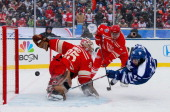 Goaltender Jimmy Howard of the Detroit Red Wings makes a save on a scoring attempt by Nazem Kadri of the Toronto Maple Leafs in the second period...