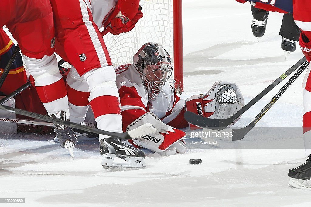 Goaltender <a gi-track='captionPersonalityLinkClicked' href=/galleries/search?phrase=Jimmy+Howard&family=editorial&specificpeople=2118637 ng-click='$event.stopPropagation()'>Jimmy Howard</a> #35 of the Detroit Red Wings reaches out while on the ice to make a save against the Florida Panthers at the BB&T Center on December 10, 2013 in Sunrise, Florida. The Panthers defeated the red Wings 3-2 in a shootout.