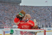 Goaltender Jimmy Howard of the Detroit Red Wings takes a drink of water during a break in game action in the first period of the 2014 Bridgestone NHL...