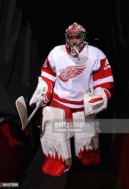 Goaltender Jimmy Howard of the Detroit Red Wings walks out onto the ice for warm ups to the Game One of the Western Conference Quarterfinals against...